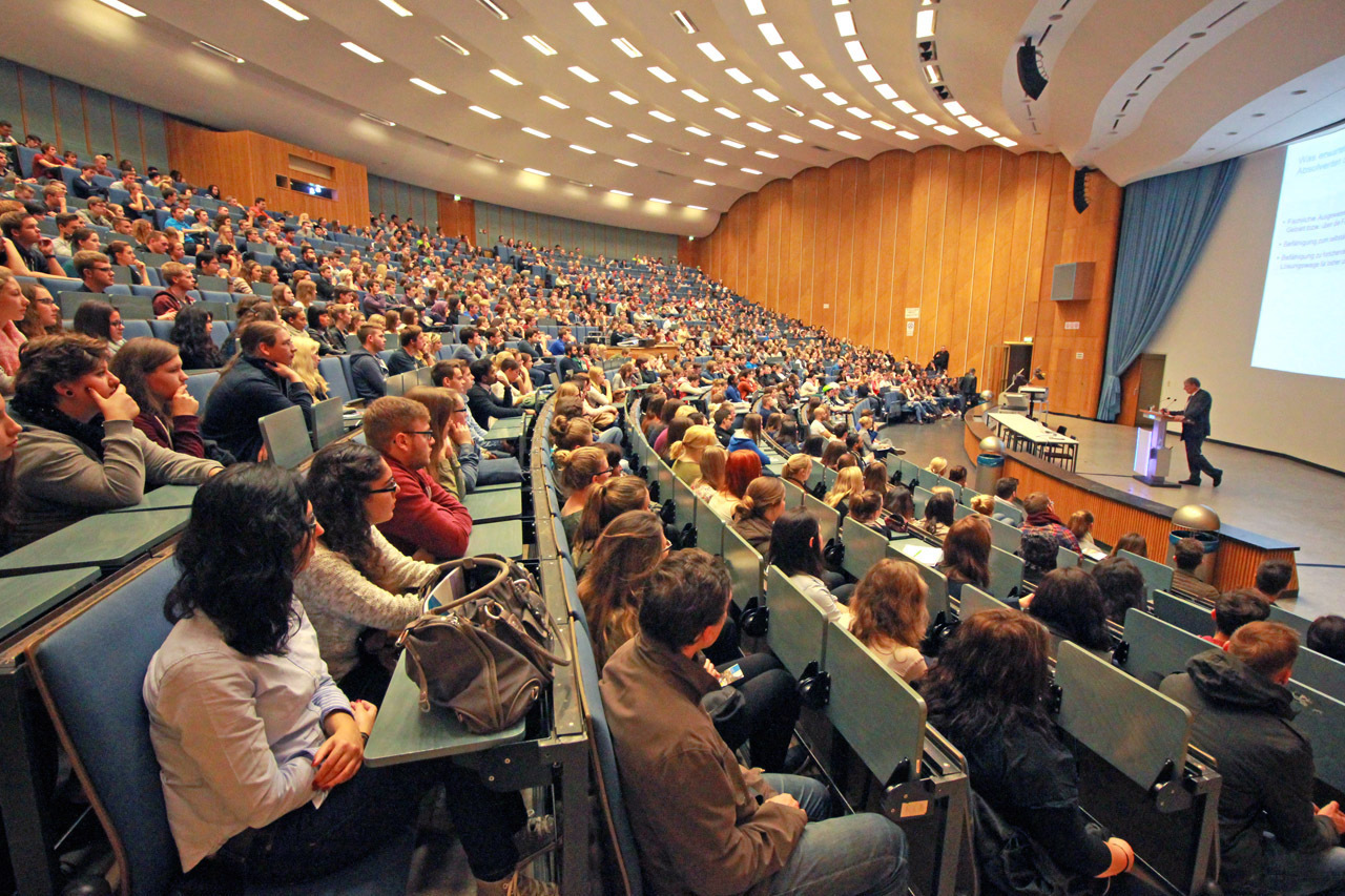 Students in a lecture hall at the orientation welcome